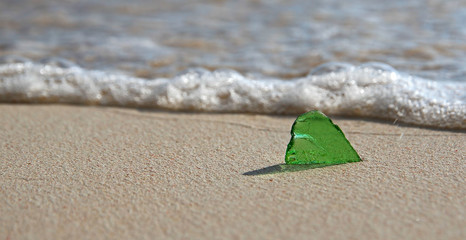 Single Green Sea Glass on the Shore