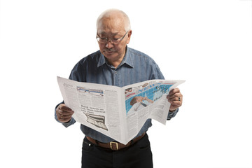 Asian men  reads newspaper