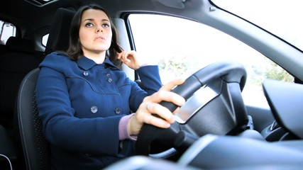 Woman putting on seatbelt in car ok sign