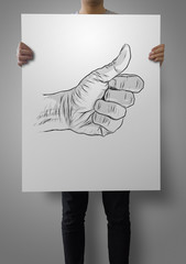 man showing poster hand drawn of hand giving a thumbs up as conc