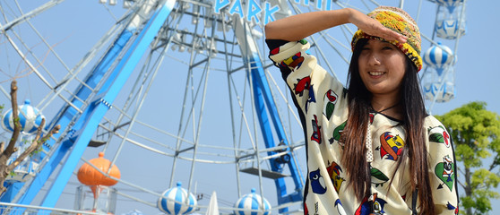 Portrait thai women with Ferris wheel