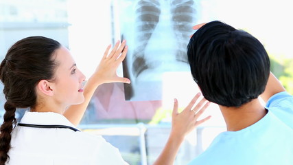 Doctor and nurse discussing xray