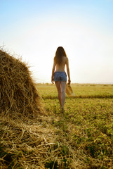 Half-naked girl in the hay