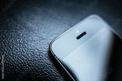 Smartphone on leather background - 64444661