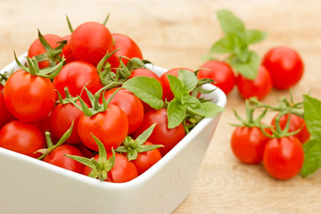 Cherry tomato in a bowl on the table