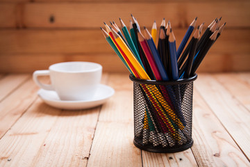 holder basket full of pencils with coffee cup