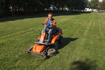 Ride-on lawn mower cutting grass.