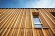 Leinwanddruck Bild - Holzhaus Holzfassade moderne Fassade profiliert Vollholz