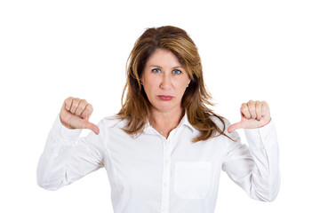 Middle aged woman showing thumbs down hand gesture