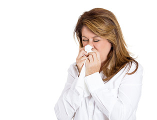 Colds, allergies. Sick Woman blowing her nose, white background