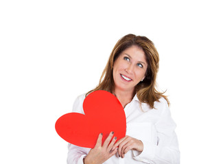 Portrait woman in love holding red heart on white background