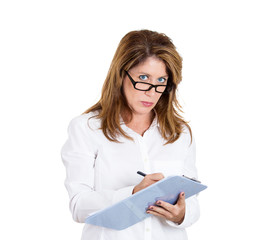 Portrait mature business woman taking meeting notes
