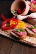 Composition with knife,  tasty sandwiches with salami sausage,