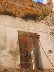 old door opened in a damaged building
