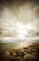 Clouds, rock and sea