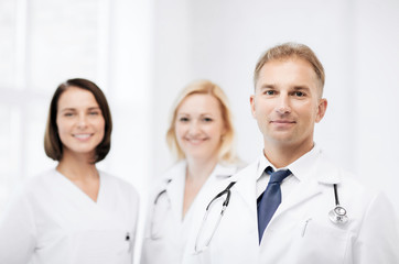 doctor with stethoscope and colleagues