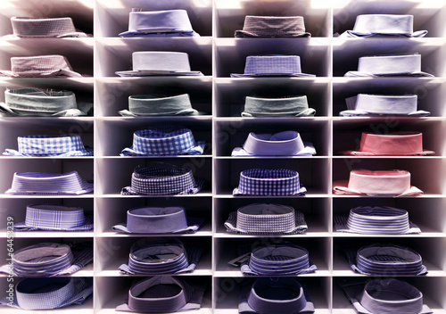 Folded colourful shirts on clothes rack