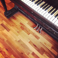 Vintage piano on old wooden floor
