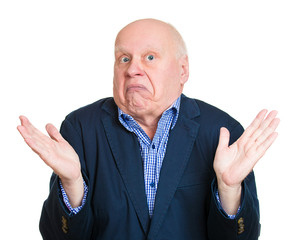 So what? Elderly senior man shrugs his shoulders on white