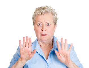 Portrait shocked stressed senior woman asking to stop