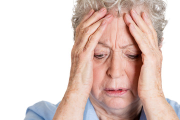 Portrait, headshot elderly woman having headache, stress