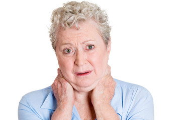 Headshot senior elderly woman with neck pain on white background