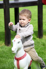 2 years old Baby boy playing with horse