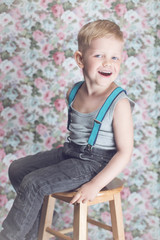 Portrait of funny little boy laughing