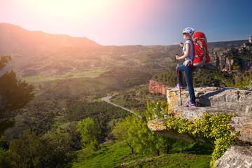Female hiker standing on cliff. Siurana, Spain