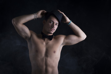 Shirtless young latino man with black fedora hat