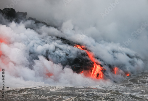 Red hot lava flowing into Pacific Ocean on Big Island, Hawaii - 64458801