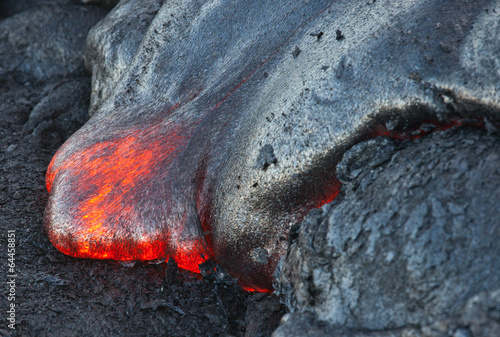 Red hot lava flowing into Pacific Ocean on Big Island, Hawaii - 64458851