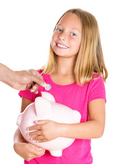Savings. Happy smiling girl with piggy bank depositing coin