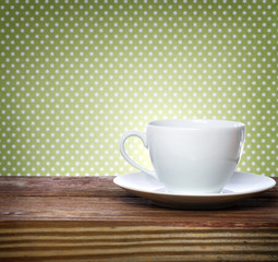 Coffee cup on polkadots background