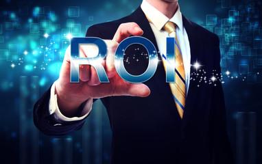 Businessman touching ROI (return on investment)