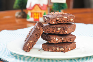 a pile of nutty milk chocolate coated brownies