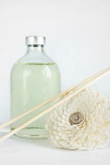 Sandalwood oil in a glass bottle and sticks for spa procedures
