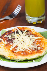 traditional bibingka with cheese on top