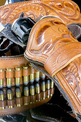 bullets and six shooter pistol in a holster
