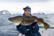 Happy angler with huge cod fish