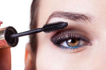 Woman using mascara