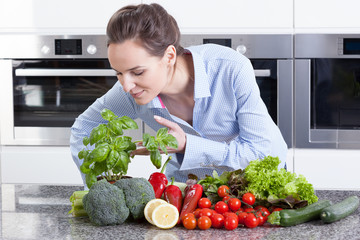 Woman smelling fresh basil