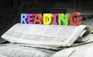 Word reading on newspaper