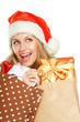 young woman with Santa hat holding shopping bags