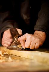 Senior man doing woodworking