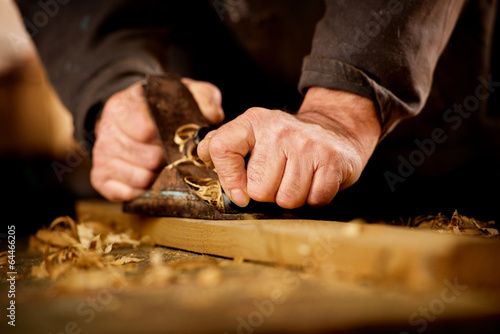 Senior man doing woodworking