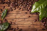 Fototapety Coffee beans and green leaves