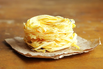 Healthy homemade fresh pasta on a parchment paper