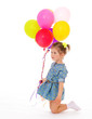 Charming girl with balloons.