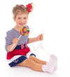 charming little girl with a lollipop.
